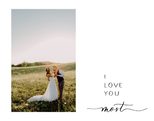 """A bride and groom facing each other almost in a dance pose. There is a hilly landscape, with a few trees in the background. Text to the right of the photo says, """"I love you most'"""